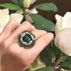 "palmierojewelleryA precious tourmaline is entrapped into a crown of soft and sweet petals. The ""Green"" stays for happiness and energy. Captured Stone Collection by Carlo Palmiero."
