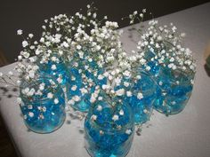 Baby boy shower. Baby food jars with blue floral beads and baby's breath. We put these everywhere in the house for the shower.
