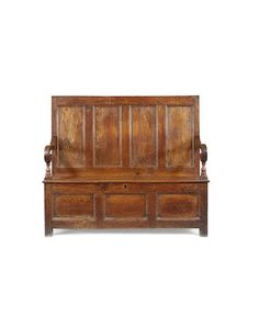 A 19th century joined oak box-base settle, possibly mid-Wales, circa 1850 - 1870 - With quadruple-panelled high back and downswept scroll-under open-arms on baluster-turned front supports, the box compartment accessed by a small removable board to the front centre of the seat, above a triple-panelled front, 134.5cm wide x 47cm deep x 116cm high, (52 1/2in wide x 18 1/2in deep x 45 1/2in high)