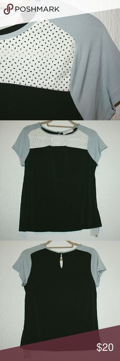 Color Block Top w/ Laser Cut Faux Leather NWOT I love this stylish color block top! The laser cut faux leather detail on the yoke is both modern and feminine. It's comfortable and easy to dress up or down. The stretch knit fabric is 96% polyester and 4% spandex. Grayson Tops Blouses