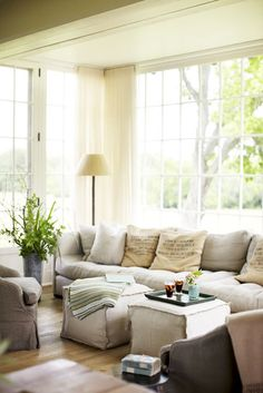 Love the windows, couch, colors