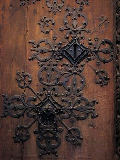 Medieval Norwegian door lock. ~ this detailing could be done with a lesser expensive material.