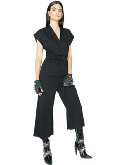 All Me Tie Waist Jumpsuit cuz you do you no matter what. This black jumpsuit has a drawstring tie waist, v neckline, and cropped legs.