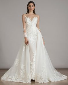 LIANCARLO lace wedding dress with lace overskirt, illusion sweetheart neckline and long illusion sleeves from Fall 2016 | https://www.theknot.com/content/liancarlo-wedding-dresses-bridal-fashion-week-fall-2016