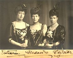"This is a well known 1908 photo of spectacularly dressed Queen Alexandra flanked by her daughter Victoria (""Toria"") to left and sister Dagmar to right."