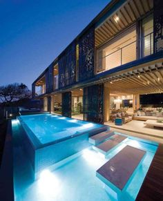 Home Design:Exotic Building Applying Artistic Building Impression Blue Pool Under La Lucia Back Yard Among Concrete Footings Near Cozy Patio Also Wooden Pergola