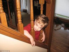 Let me out: This toddler looked very pleased with himself after getting stuck
