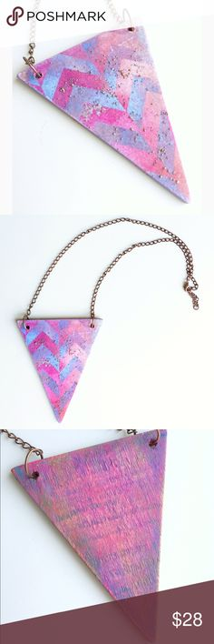 OOAK handmade paper & wood triangle necklace This one of a kind decoupaged triangle necklace will add a little something unique to your outfit. Personally designed and handmade. Comes on a jewelry card. Though it's water resistant I don't recommend jumping in the pool or showering with it on. Price is firm at the moment.  Condition: brand new Measurements: to be added Materials: wood, paper, paint, embossing powder, copper-colored brass Handmade Jewelry Necklaces