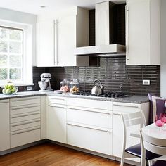 On this backsplash, long rectangular tiles feature rich brown (almost black) color that provides warm balance with white cabinetry, while giving the walls a sense of depth.