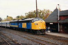 """Caption: A nice clean paint job (sans """"VIA"""" nose)on VIA 6501 as she slows to a stop at the Parry Sound CP station in order to pick up passen..."""