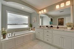 Master Bathroom with big, soaking tub, his and her sinks & granite countertops - Creek Hill Custom Homes MN