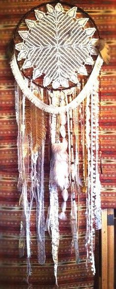 Love this vintage shabby chic looking dream catcher. Nice take on the original styles