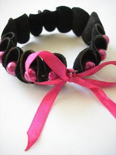 pink and black leather bracelet