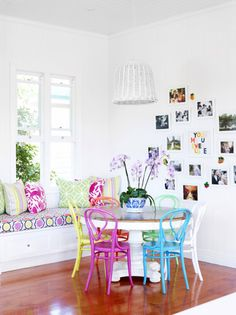 Window seat & the multi colored chair look I adore. Breakfast nook perfection
