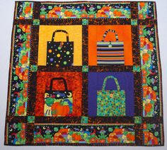 """A colorful, family friendly Halloween quilt/wall hanging.  The bags are even """"real"""" and can hold a small amount of #Halloween treats!  #trickortreat"""