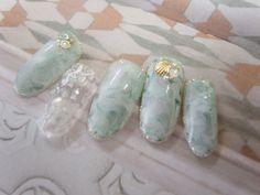sheer white & aqua marble manicure