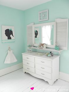 Beautiful use of soft colors too.. organized girls room