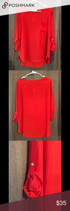 Ann Taylor Loft Blouse Never worn - tags still attached. Smoke free/pet free home. This is a great red blouse that you can wear as 3/4 sleeve or undo the buttons on the sleeve for long sleeves. 100% polyester. LOFT Tops Blouses