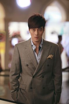 He have brown hair, tall,brown eyes and he look . His looks will be similar to my main character