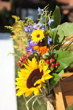 Sunflower Wedding Flowers - this is gorgeous! LOVE hypericum!   This would be pretty on the stairs. Seeing lots of the feathery flower in these arrangements.  May need to add?