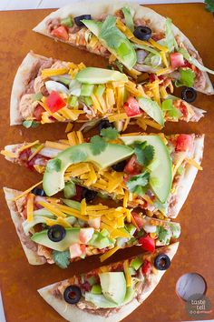 Looking for a fast, easy appetizer or main dish? This 7 Layer Flatbread Recipe takes a favorite dip and turns it into a hearty dish that is perfect for a party.: