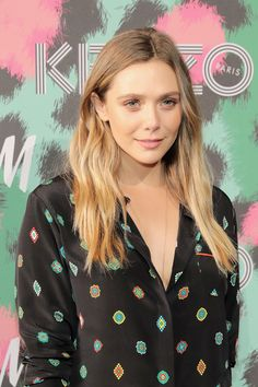 Elizabeth Olsen Long Wavy Cut - Elizabeth Olsen wore her hair loose with barely-there waves when she attended the Kenzo x H&M launch.