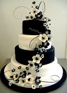 Black and white on a wedding cake? Opinions?love this. Maybe for our fiftieth I can have a cake like this