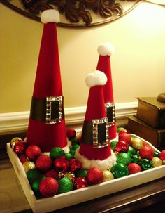 Serve up some holiday cheer with Santa decorative cones! Red velvet-covered foam cones with bejeweled Santa belts — and a fluffy cotton ball on top! — are easy to make with a little glue and the right materials. Place them on an inexpensive tray surrounded by Christmas ornaments, and mama's got herself one cute Christmas display! Source: Thrift Decor Chick