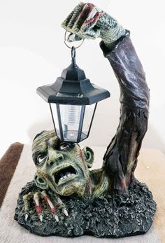 Goth Shopaholic: Quirky Zombie Home Decor Items - Zombie table lamp