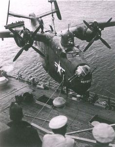 A U.S. Navy Martin PBM Mariner of Fleet Air Wing 6 is hoisted aboard the seaplane tender USS Curtiss (AV-4) after a mine-hunting patrol off North Korea during the Korean War (1950-1953).~ BFD