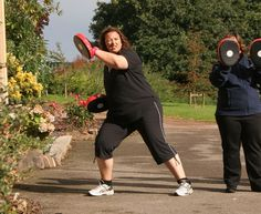BOXING DRILLS AT THE FITNESS RETREAT WEEK.  Here is a photo of one of our ladies down at the http://www.fitfarms.co.uk/ fitness and weight loss retreat in Somerset. The photo shows her doing a side lunge whilst using the focus pad to balance whilst moving to the side.