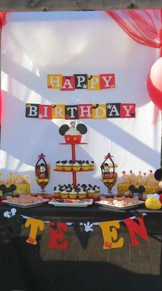 Mickey Mouse birthday party dessert table and backdrop!  See more party planning ideas at CatchMyParty.com!