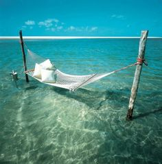 This is a place I would love to visit if I only knew where in the Hell it is. heaven, dream, the ocean, sea, beach, hammock, place, spot, island