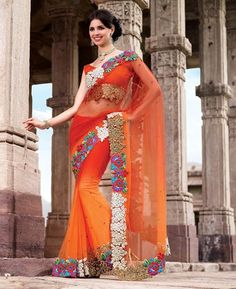 Celebrate this diwali with this beautiful orange shaded embroidered net saree.