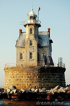 1878 gothic-revival styled Race Rock Lighthouse built of stone with corrugated metal roofs sits atop a round stone block base in NY's Long Island Sound. (Photo by Kelly Harris / Lee Snider Photo Images).USA