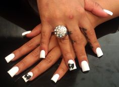 White acrylics with a black studded bow tie!