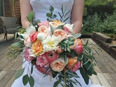 Romantic, garden style bouquet in peaches, pinks, corals, white and sage.
