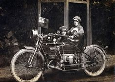 Woman on a 1912 Henderson motorcycle with her family. Good old fashioned motolady.