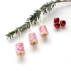 Make your own baker's twine Christmas ornaments. They are a quick and easy craft to make and look adorable on your Christmas tree.