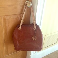 Genuine Michael Kors leather handbag Large soft leather Michael Kors bag. Camel color and in good shape- only used a few times. Always hung up for storage and well kept. Michael Kors Bags Shoulder Bags