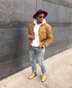 Men's Style: yellow varsity jacket, burgundy fedora hat, white sweat shirt, blue jeans, Chelsea boots