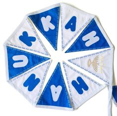 """Festive """"Happy Hanukkah"""" bunting with blue and white flags to last for years. Ideal for decoration during Hanukkah or a season's gift."""