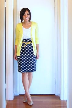 "From ""Putting Me Together"" blog as part of a longer post.  I like the layering of a solid colored cardigan over a patterned skirt and the matching belt."