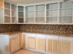 New tile backsplash with granite countertops and solid wood cabinets