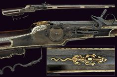 A wheel-lock rifle Germany, last quarter of the 16th Century  Rifled, octagonal, 14 mm cal. barrel, slightly bell-mouthed at the nozzle, the rear-sight in the shape of a brass stylized lion, foresight; large lock with external wheel, flat plate, spring pan cover; full stock of cherry wood, anatomic, iron trigger, set trigger.