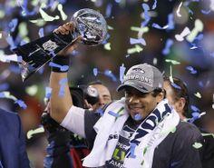 Winner: Seattle Seahawks quarterback Russell Wilson holds up the Vince Lombardi Trophy