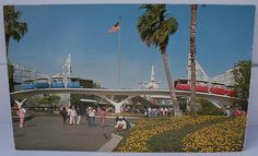 """Not as crowded back then as it is today.  Vintage Postcard """"Disneyland - Tomorrowland Entrance"""" by DisneyanaMuseumsCollection, via Flickr"""