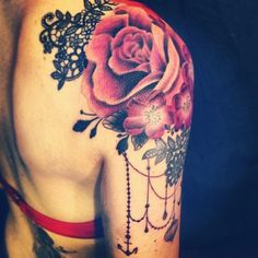 http://tattoomagz.com/shoulder-tattoos/red-flowers-shoulder-tattoo/