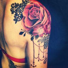 http://tattoomagz.com/shoulder-tattoos/red-flowers-shoulder-tattoo/