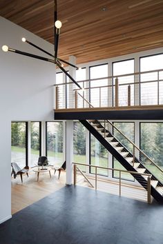 High ceilings An open-concept house doesn& need to equal one massive living space. Kamel used materials rather than walls to delineate rooms. In the double-height atrium, a natural slate floor does the trick.